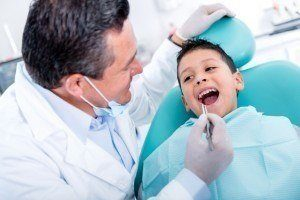 Boy patient having dental check up