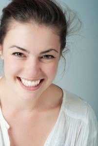 Female patient happy after cosmetic dentistry procedure