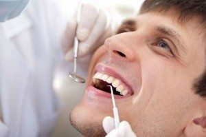 Male patient dental exam