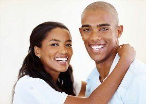 Young couple after cosmetic teeth whitening