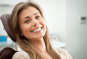 Woman with biggest smile in the world at dentist office